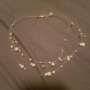 Elegant floating pearl necklace